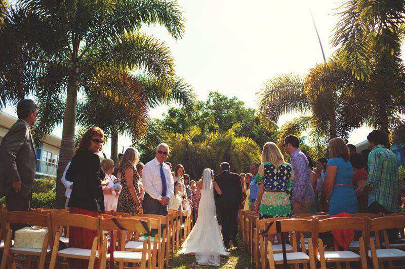 postcard inn holiday isles wedding: bride walking down isle