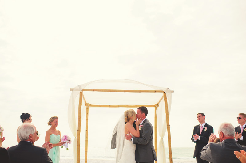 siesta key backyard wedding: first kiss