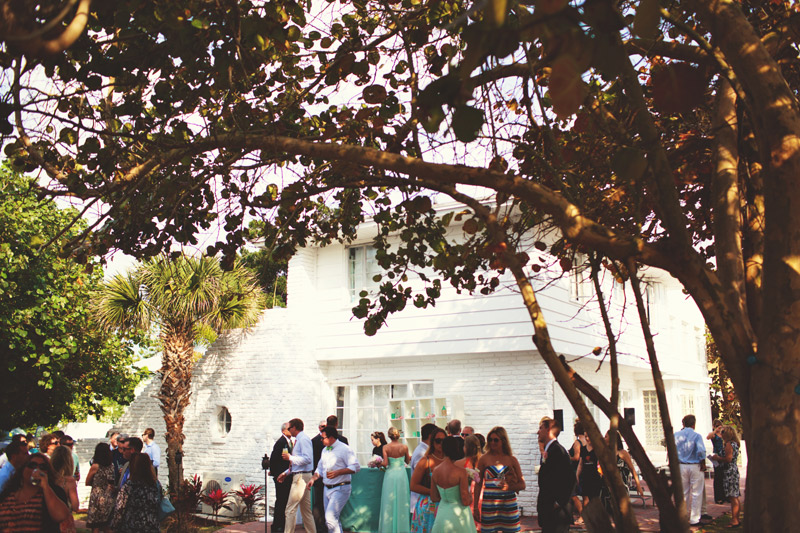 siesta key backyard wedding: cocktail hour socializing