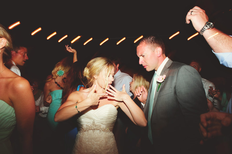 siesta key backyard wedding: bride and groom fun dancing
