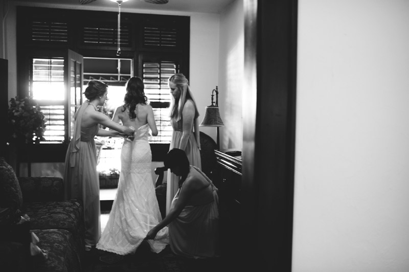 Winter Park Famers Market Wedding: bride getting into dress