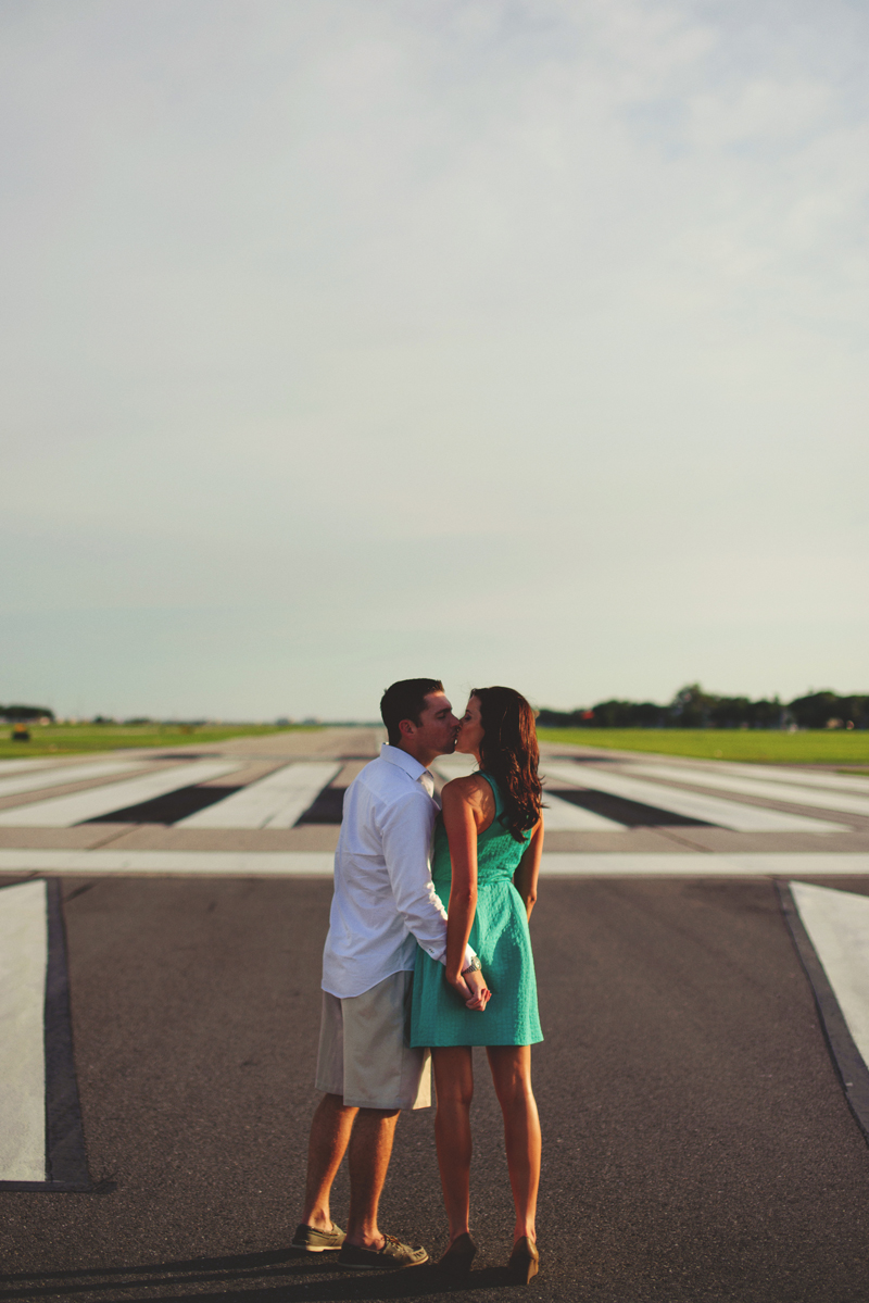 romantic airport engagement session: kissing on runway