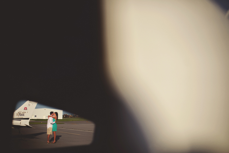 romantic airport engagement session: through a window