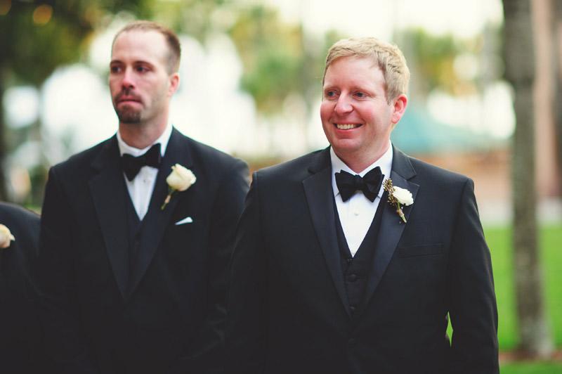 ringling museum wedding: groom smiling as bride walks down aisle