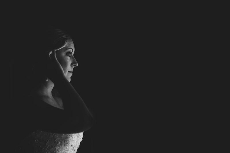 naples backyard beach wedding: bride gazing out window