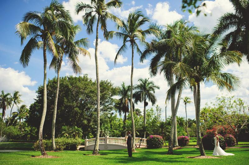 naples backyard beach wedding: first look near palm trees
