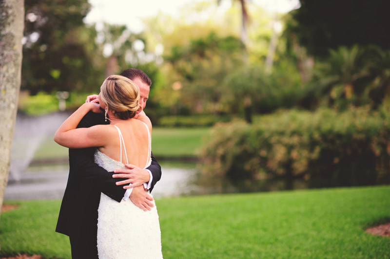 naples backyard beach wedding: bride and groom first look embracing