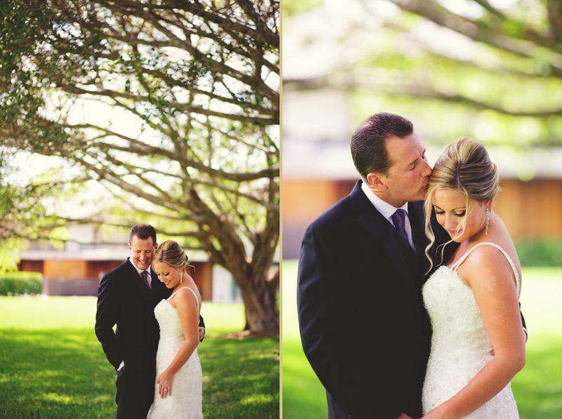 naples backyard beach wedding: bride and groom portrait under trees