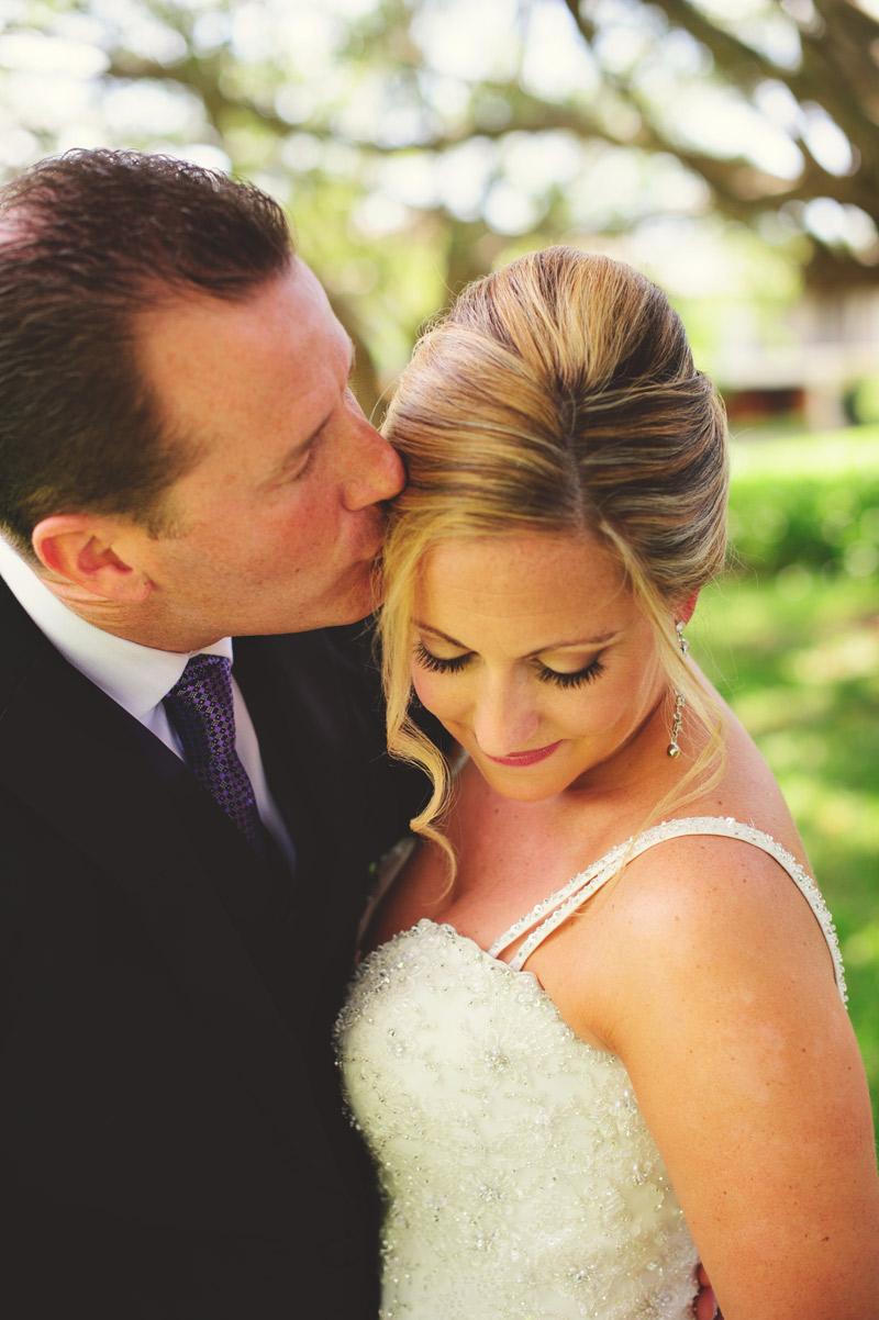 naples backyard beach wedding: bride and groom portrait kissing forehead