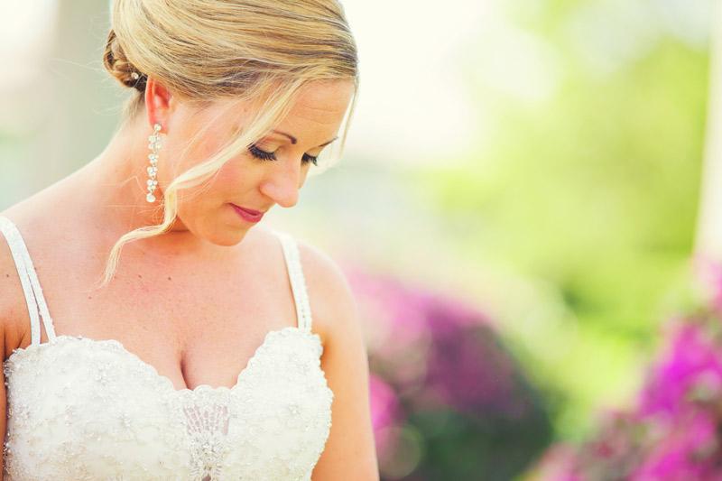 naples backyard beach wedding: bride looking down