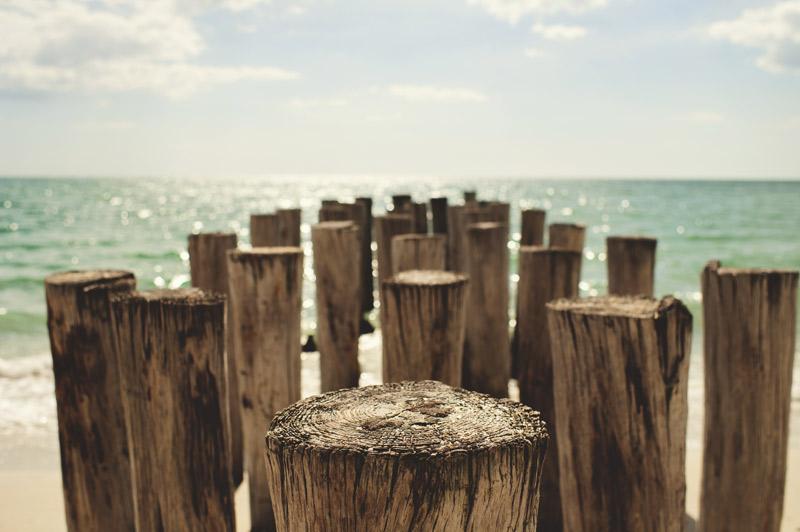 naples backyard beach wedding: ocean, pillars