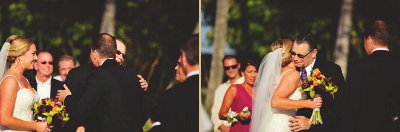 naples backyard beach wedding: father giving daughter away