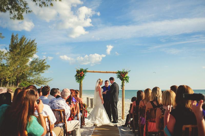 naples backyard beach wedding: groom ring exchange