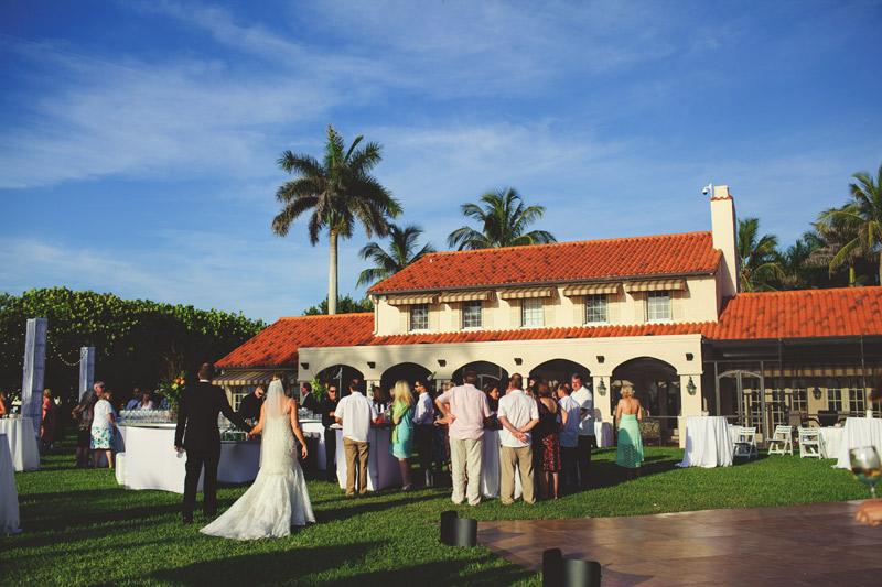 naples backyard beach wedding: bride and groom cocktail hour