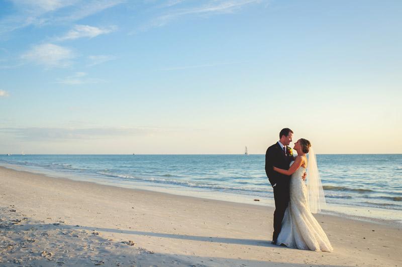 naples backyard beach wedding: beach portrait of bride and groom