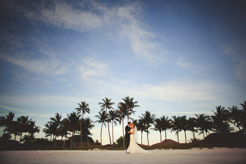 naples backyard beach wedding: palm trees, bride and groom