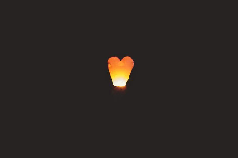 naples backyard beach wedding:  heart lantern release