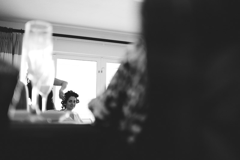 casa ybel resort wedding: bride getting hair done