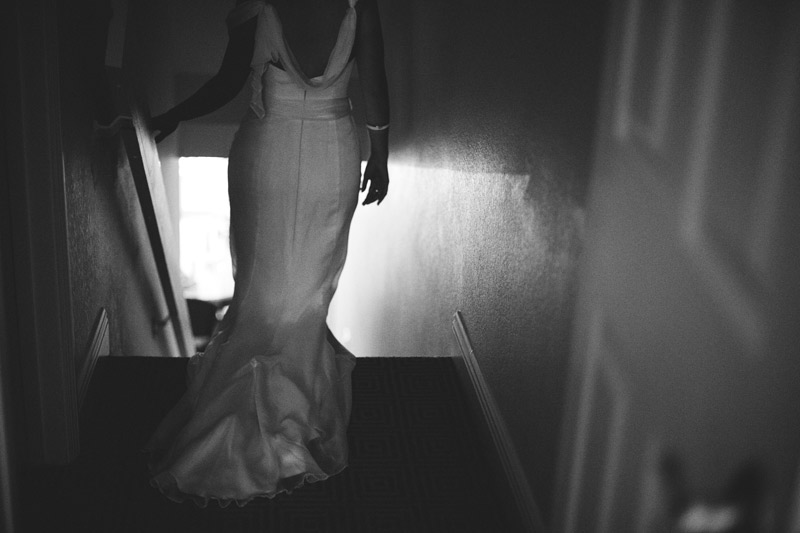 sanibel island wedding: bride walking down stairs