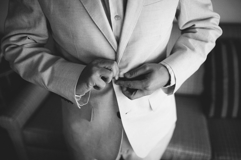 sanibel island wedding: buttoning jacket