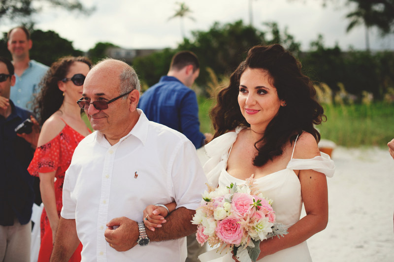 sanibel island wedding: happy bride walking down aisle