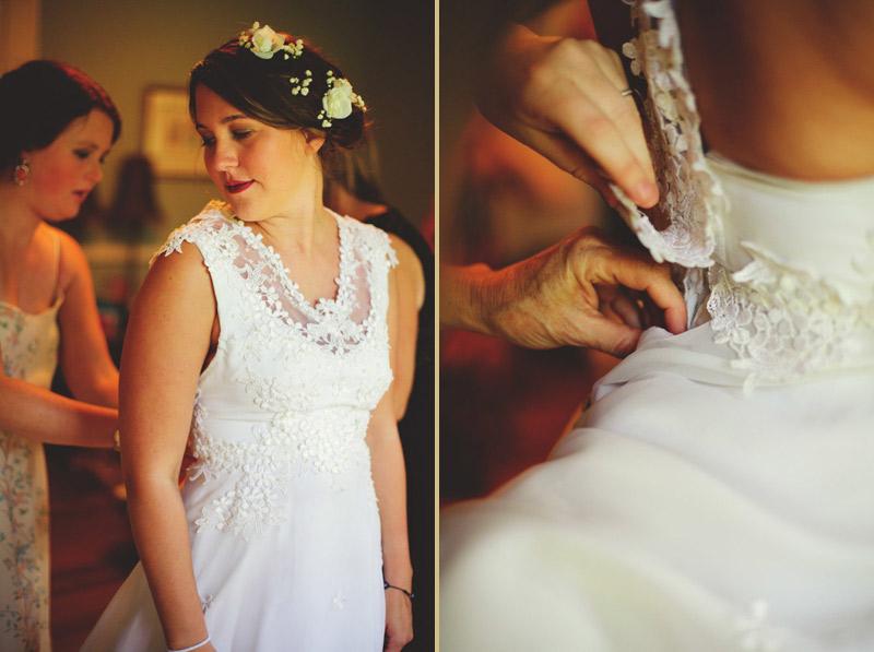 the glen venue wedding: bride putting on dress