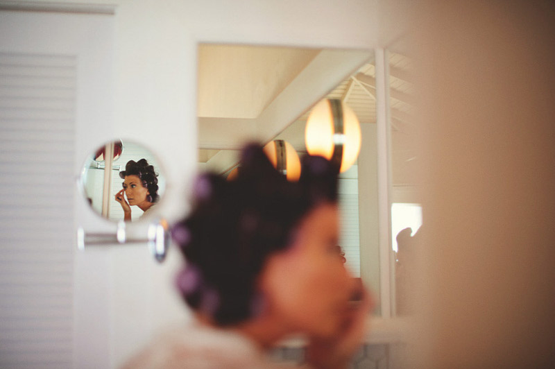 harbour island bahamas wedding: bride doing make up