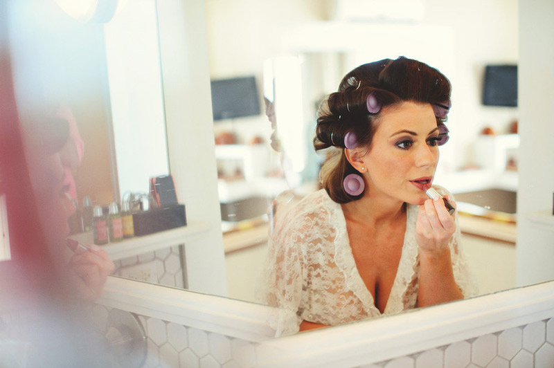 harbour island bahamas wedding: bride putting on lipstick
