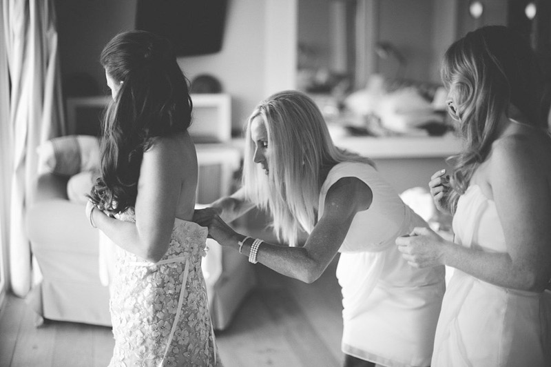 harbour island bahamas wedding: bride putting dress on