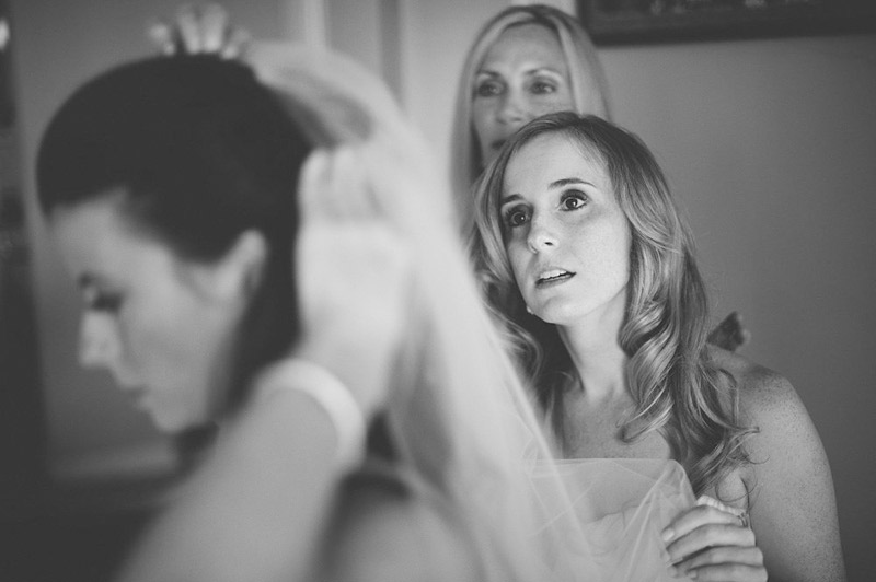harbour island bahamas wedding: bride putting on veil