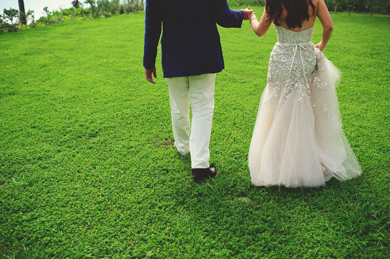 harbour island bahamas wedding: bride and groom walking