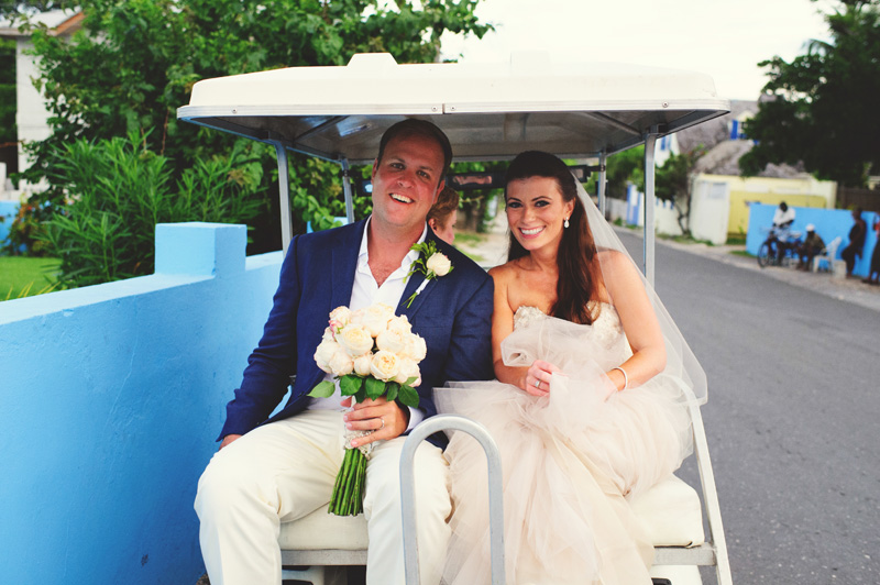 harbour island bahamas wedding: bride and groom on golf cart