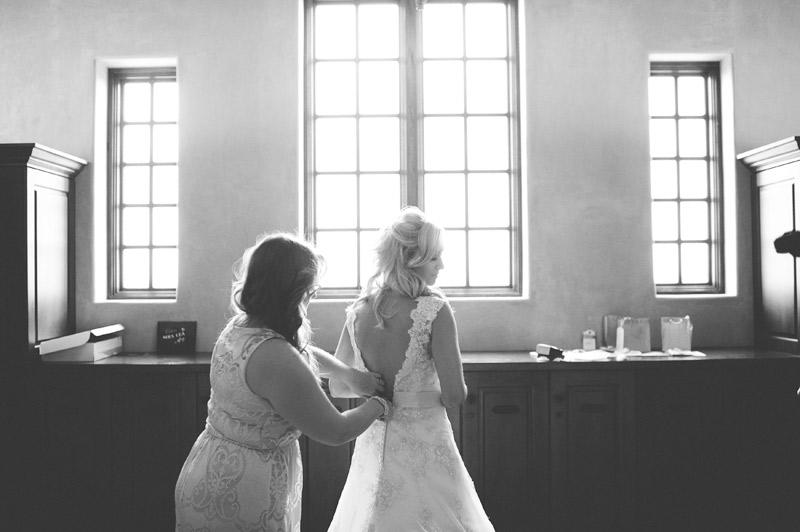 bella collina wedding: bride put on wedding dress