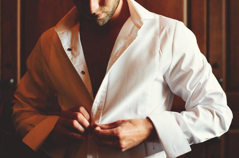 bella collina wedding: grooms thomas pink shirt