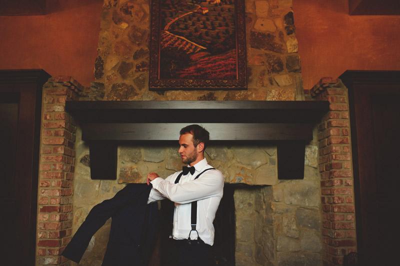 bella collina wedding: groom putting on jacket