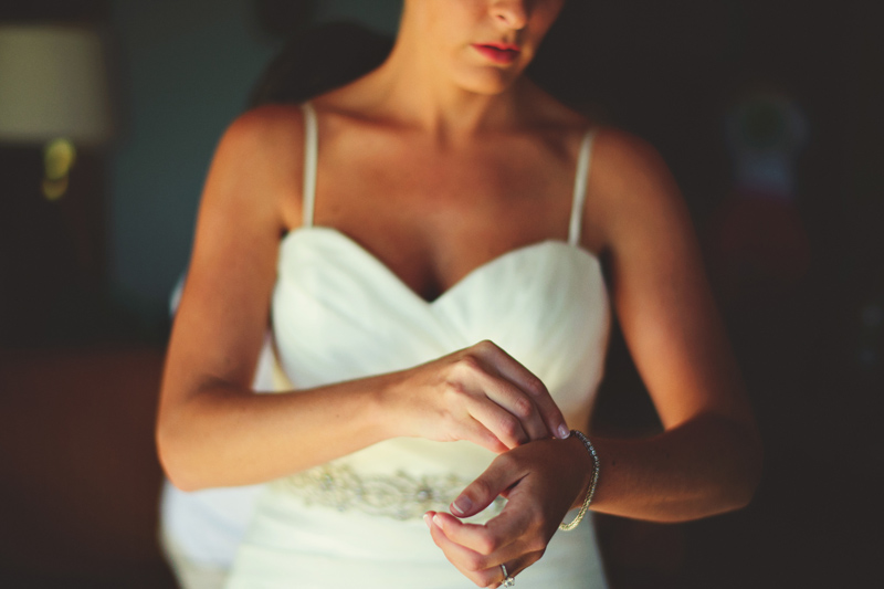 caribbean resort wedding: bride putting on bracelet
