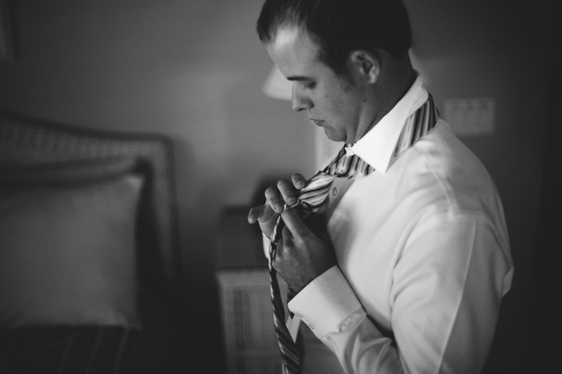 caribbean resort wedding: groom tying tie