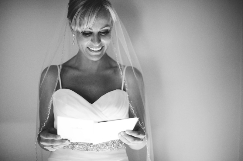caribbean resort wedding: bride reading letter