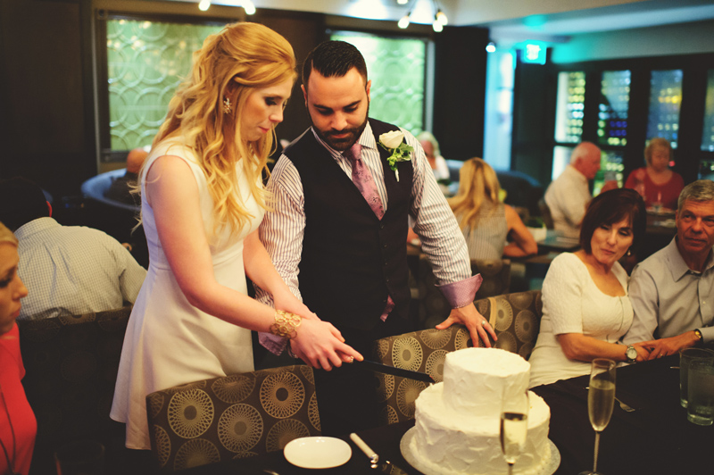st pete elopement:  bride and groom cutting cake