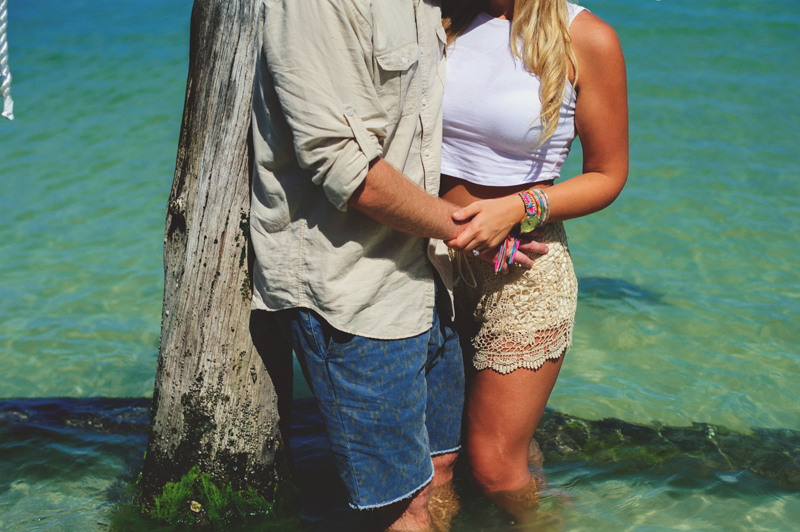 boho beach engagement photos: in water
