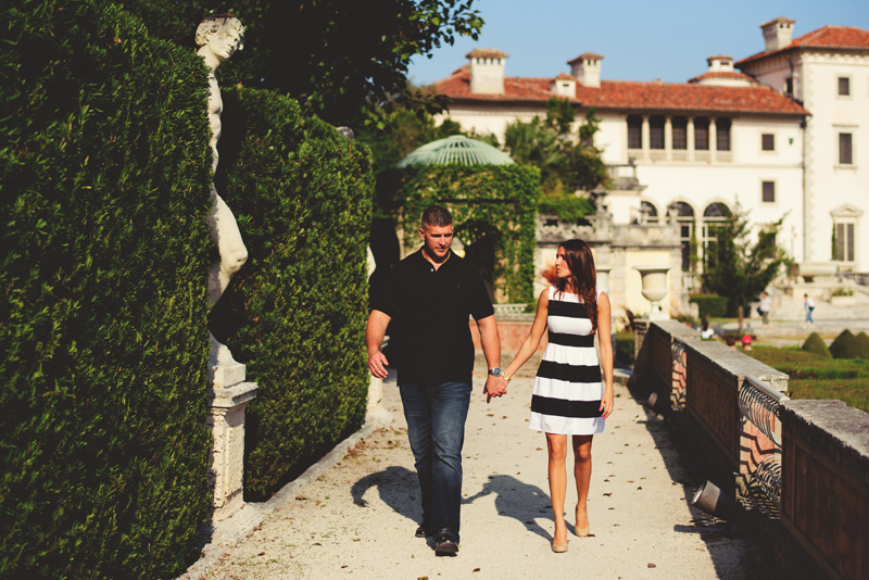 vizcaya museum engagement: bride and groom walking