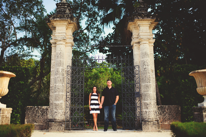vizcaya museum engagement: bride and groom iron gates