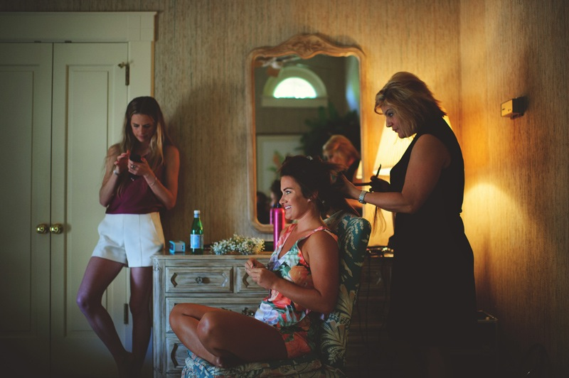 boho backyard wedding naples: bride getting her hair done