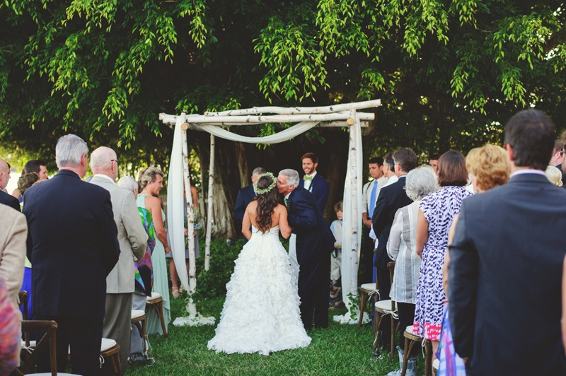 boho backyard wedding naples: dad kissing bride