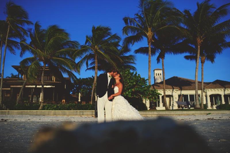 boho backyard wedding naples: bride and groom kissing