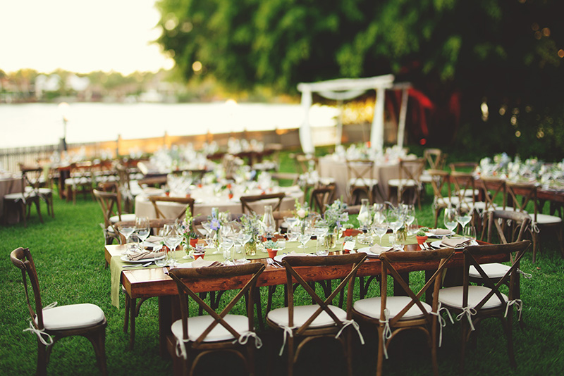 boho backyard wedding naples: farm tables and wild flowers