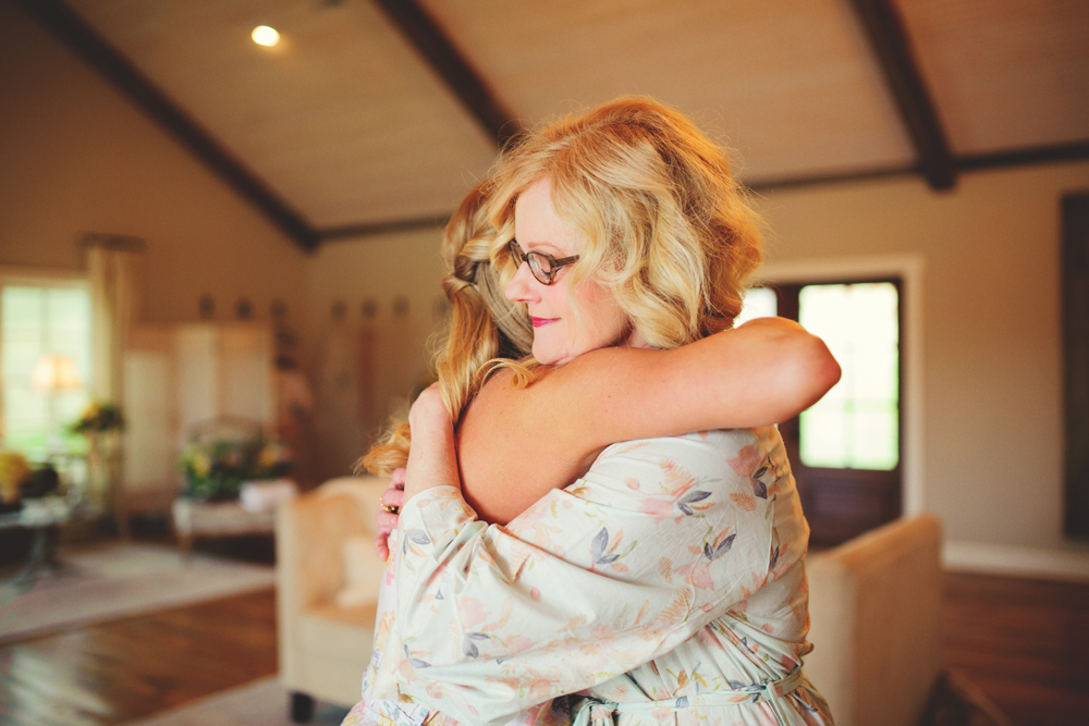 mint springs farm wedding: bride hugging mom