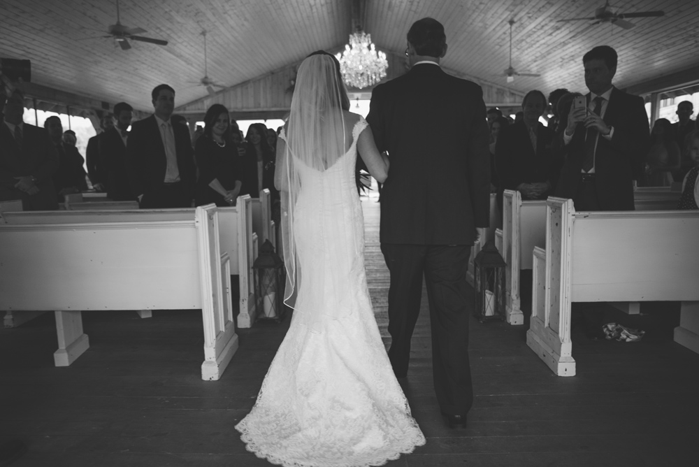 mint springs farm wedding: bride walking down aisle
