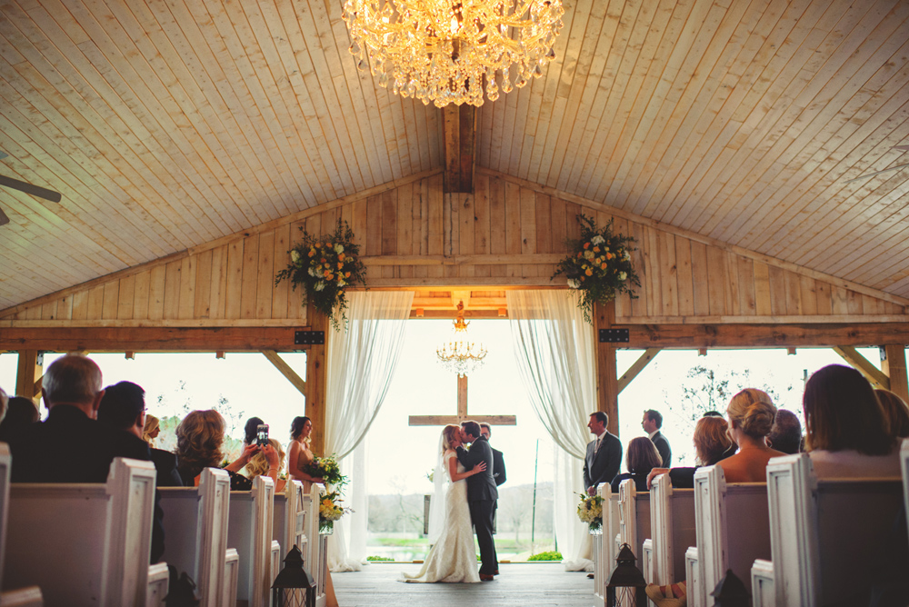 mint springs farm wedding: first kiss
