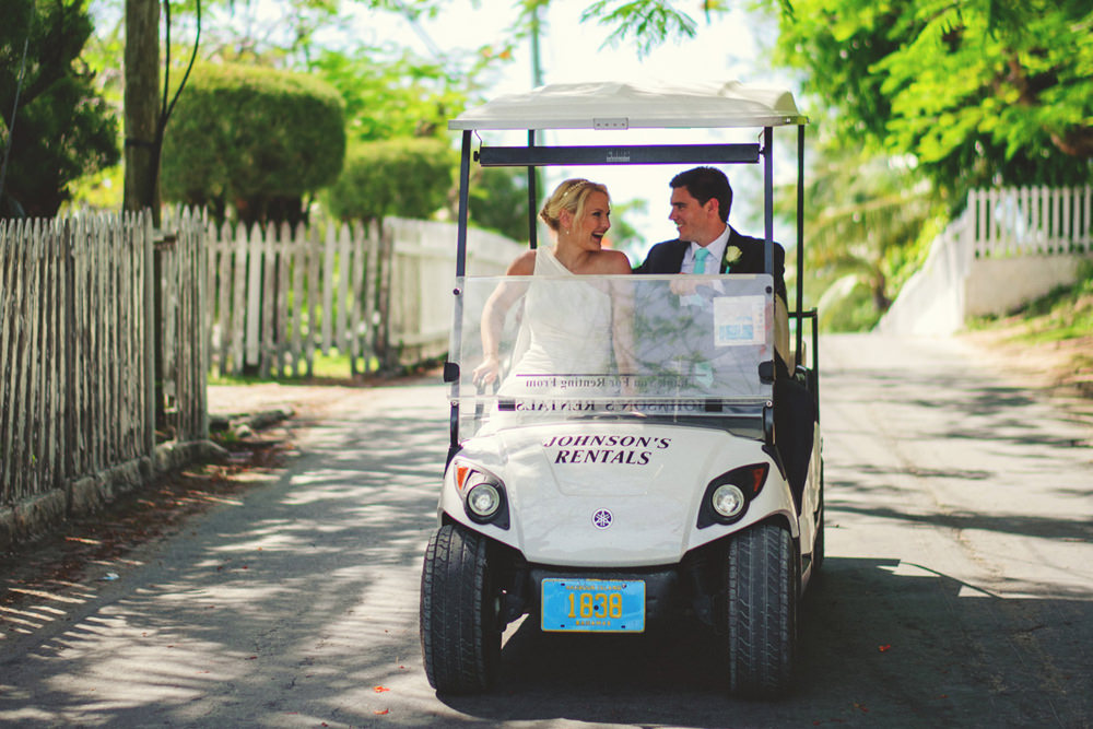 ocean view club wedding : bride and groom on a golf cart